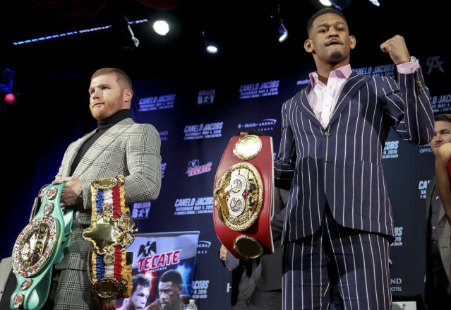 WBC and WBA middleweight world champion Canelo Alvarez (50-1-2, 34 KOs), left, and IBF middleweight world champion Daniel Jacobs (35-2, 29 KOs), right, pose with their title belts during a pre-fight press conference on Wednesday, Feb. 27, 2019, in New York. Alvarez and Jacobs meet in a 12-round unification bout in Las Vegas, on Saturday May, 4, 2019. (AP Photo/Bebeto Matthews)