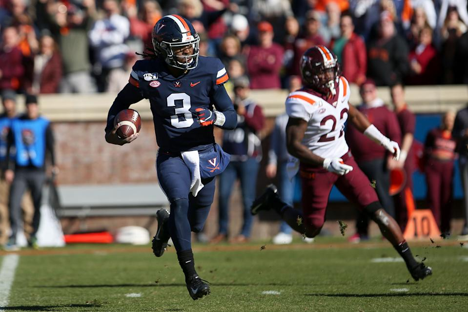 CHARLOTTESVILLE, VA - NOVEMBER 29: Bryce Perkins #3 of the Virginia Cavaliers rushes for a touchdown in the first half during a game against the Virginia Tech Hokies at Scott Stadium on November 29, 2019 in Charlottesville, Virginia. (Photo by Ryan M. Kelly/Getty Images)