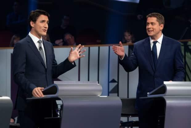 Liberal Leader Justin Trudeau and then-Conservative Leader Andrew Scheer are seen taking part in the federal leaders' French-language debate in Gatineau, Que., on Oct. 10, 2019. (Adrian Wyld/The Canadian Press - image credit)