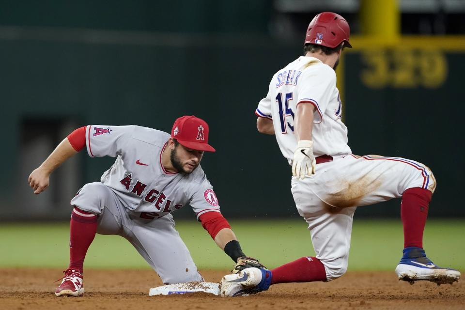 Los Angeles Angels second baseman David Fletcher (22) tags out Texas Rangers' Nick Solak (15) who was attempting to steal the bag in the third inning of a baseball game in Arlington, Texas, Tuesday, Sept. 28, 2021. (AP Photo/Tony Gutierrez)