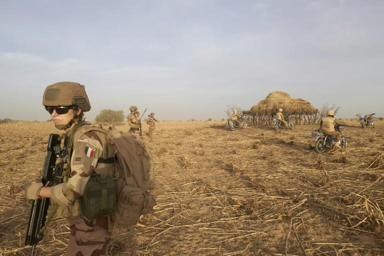 A soldier of the French Army patrols a rural area during the Barkhane operation in northern Burkina Faso on November 9, 2019