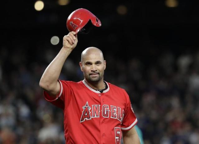 Angels slugger Albert Pujols acknowledges the crowd at Safeco Field in Seattle after becoming the 32rd member of the 3,000 hit club. (AP)