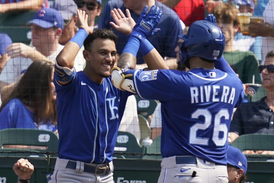 Kansas City Royals' Emmanuel Rivera, right, celebrates with Nicky Lopez after hitting a solo home run in the fifth inning of a baseball game against the Chicago Cubs, Friday, Aug. 20, 2021, in Chicago. (AP Photo/Nam Y. Huh)