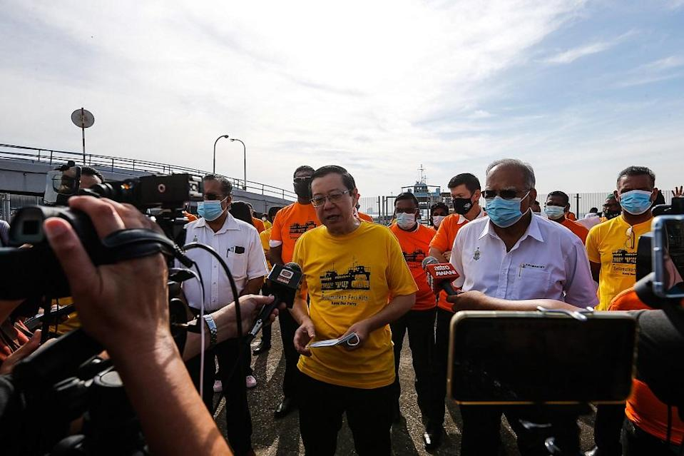Lim Guan Eng speaks to reporters before board the ferry service for the last time at the Pengkalan Raja Tun Uda Terminal  December 31, 2020.  ― Picture  by Sayuti Zainudin