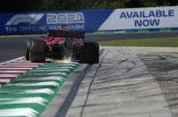 Ferrari driver Charles Leclerc of Monaco steers his car during the second free practice at the Hungaroring racetrack in Mogyorod, Hungary, Friday, July 30, 2021. The Hungarian Formula One Grand Prix will be held on Sunday. (AP Photo/Darko Bandic)