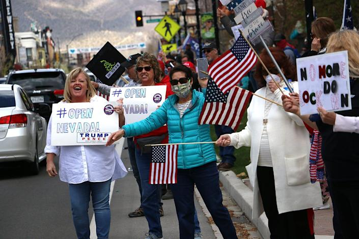 A large crowd gathers for a rally Saturday in Carson City in favor of reopening Nevada's economy.