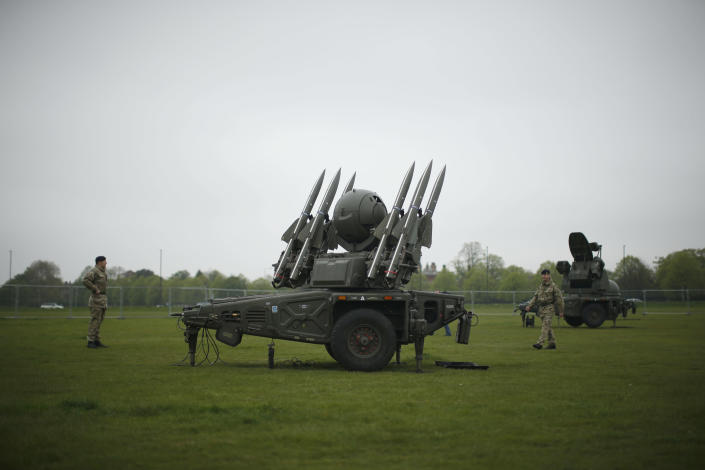 FILE - In this Thursday, May 3, 2012 file photo members of the British military's Royal Artillery regiment stand near a Rapier air defence system during a media event ahead of a training exercise designed to test military procedures prior to the Olympic period in Blackheath, London. The British military plans to deploy surface-to-air missiles at six sites around London as part of security measures for the July 27- Aug. 12 games. The layer of the residents of the 17-story Fred Wigg Tower in Leytonstone, east London, told the High Court on Monday, July 9, 2012 that residents fear the missiles could make the building a terrorist target. (AP Photo/Matt Dunham, File)