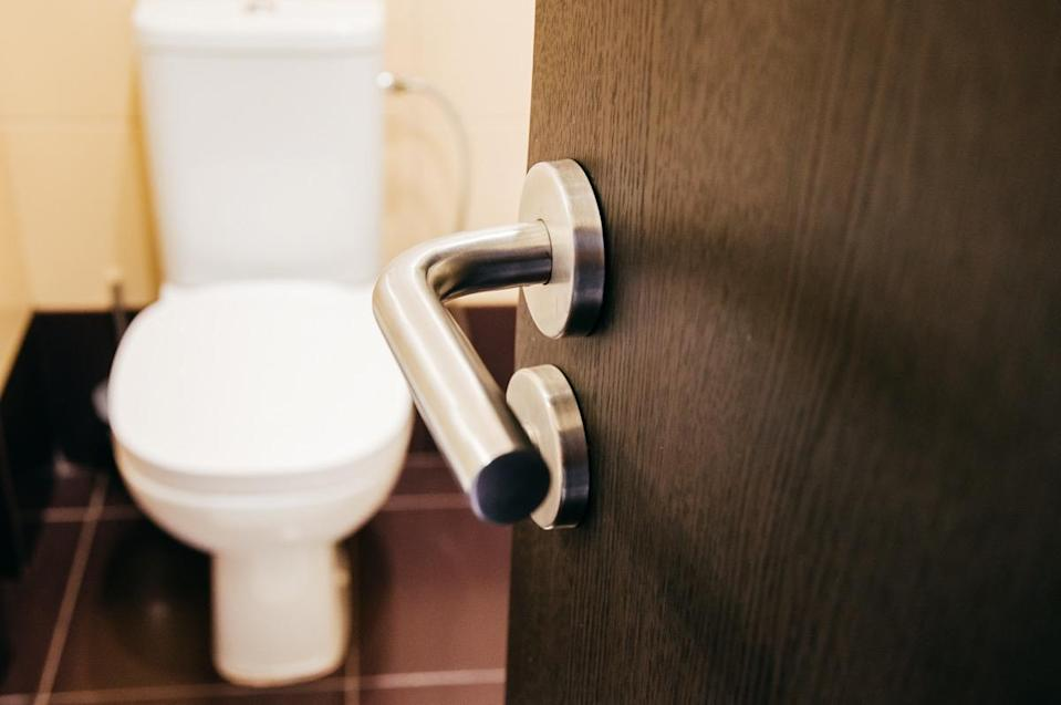 Door handle open to toilet can see toilet