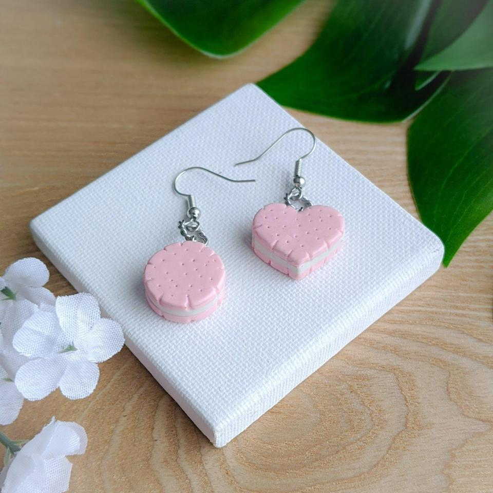 "<h2>Shortbread Cookie Sandwich Earrings</h2><br><a href=""https://www.etsy.com/shop/CraftyLittleDreams"" rel=""nofollow noopener"" target=""_blank"" data-ylk=""slk:CraftyLittleDreams"" class=""link rapid-noclick-resp"">CraftyLittleDreams</a> designs pieces that are just that — crafty. Equal parts adorable and artistic, these little earrings come in a variety of silhouettes but we're particularly fond of the shortbread. Custom requests are available. <br><br><em>Shop <strong><a href=""https://www.etsy.com/shop/CraftyLittleDreams"" rel=""nofollow noopener"" target=""_blank"" data-ylk=""slk:Crafty Little Dreams"" class=""link rapid-noclick-resp"">Crafty Little Dreams</a></strong></em><br><br><strong>CraftyLittleDreams</strong> Shortbread Cookie Sandwich Earrings, $, available at <a href=""https://go.skimresources.com/?id=30283X879131&url=https%3A%2F%2Fwww.etsy.com%2Flisting%2F775357835%2Fshortbread-cookie-sandwich-earrings"" rel=""nofollow noopener"" target=""_blank"" data-ylk=""slk:Etsy"" class=""link rapid-noclick-resp"">Etsy</a>"