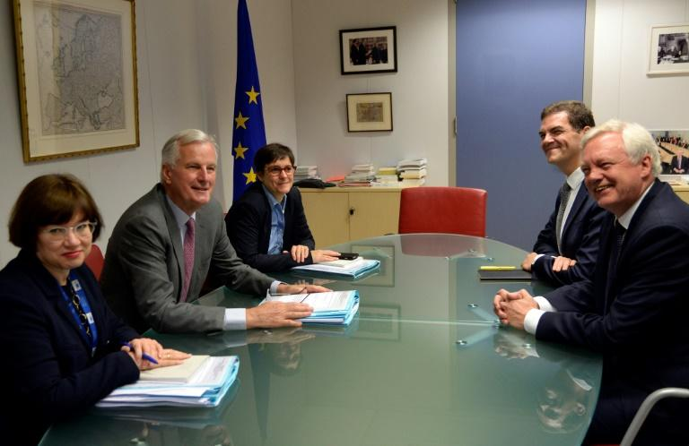 Britain's Brexit Minister David Davis (R) and European Union Chief Negotiator in charge of Brexit negotiations with Britain Michel Barnier (2nd L) pictured during a meeting at the EU Commission headquarters in Brussels on July 17, 2017
