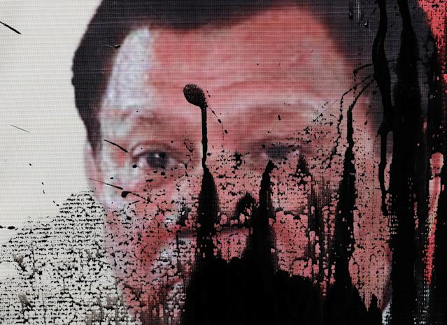 <p>An image of Philippines' President Rodrigo Duterte is pictured after it was smeared with paint during a rally against the visit of President Donald Trump near the U.S. Embassy, in Manila, Philippines, Nov. 10, 2017. (Photo: Erik De Castro/Reuters) </p>