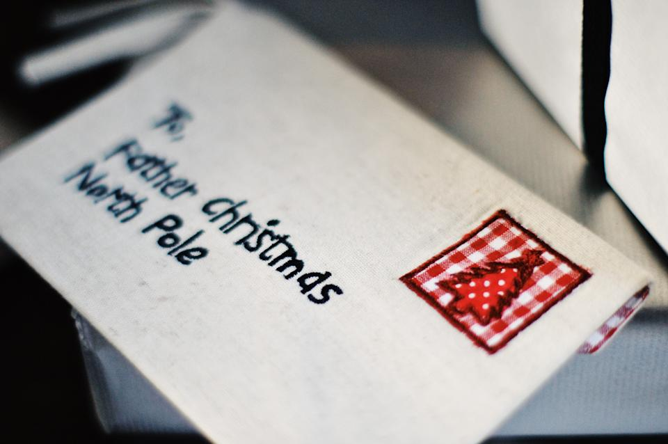 Envelope made of cotton with sewn written text to Father Christmas, Santa Claus the North Pole and stamp