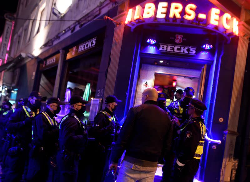 Police controls ID's and guest lists due to restrictions against the spread of the coronavirus disease (COVID-19) at a pub at famous red-light-district Reeperbahn in Hamburg