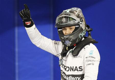 Mercedes Formula One driver Nico Rosberg of Germany celebrates after taking pole position at the qualifying session of the Bahrain F1 Grand Prix at the Bahrain International Circuit (BIC) in Sakhir, south of Manama April 5, 2014. REUTERS/Thaier Al-Sudani