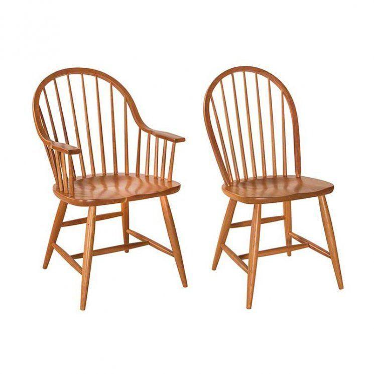 """<p>vermontwoodsstudios.com</p><p><strong>$752.00</strong></p><p><a href=""""https://vermontwoodsstudios.com/products/contemporary-windsor-chair"""" rel=""""nofollow noopener"""" target=""""_blank"""" data-ylk=""""slk:Shop Now"""" class=""""link rapid-noclick-resp"""">Shop Now</a></p><p>The Windsor chair, characterized by its spindled chair back, has a history as old as the United States. The exact origins of the chair style remain somewhat murky, but Windsor chairs are thought to have first been produced as the 16th century in Ireland and Wales. English settlers introduced them to North America, where they continued to gain popularity. Many American models are made by Amish woodworkers. </p>"""