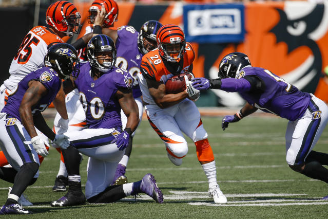 <p>Cincinnati Bengals running back Joe Mixon (28) runs the ball against Baltimore Ravens inside linebacker C.J. Mosley, right, in the first half of an NFL football game, Sunday, Sept. 10, 2017, in Cincinnati. (AP Photo/Frank Victores) </p>