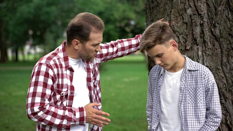 Strict dad scolding son for bad marks at school, parent respect, upbringing