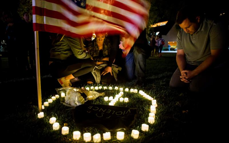 Mourners at a vigil in Thousand Oaks, California - AFP