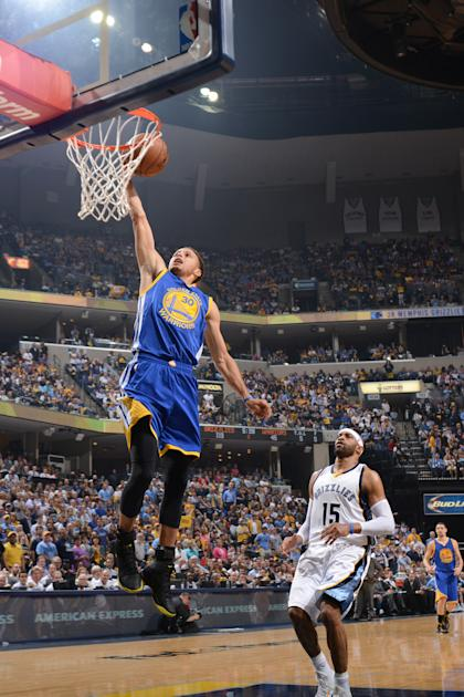 MEMPHIS, TENNESSEE - MAY 11: Stephen Curry #30 of the Golden State Warriors dunks against Vince Carter #15 of the Memphis Grizzlies during Game Four of the Western Conference Semifinals for the NBA Playoffs on May 11, 2015 at FedExForum in Memphis, Tennessee. (Photo by Noah Graham/NBAE via Getty Images)