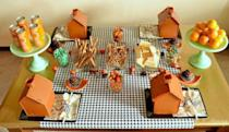 """<p>Just like a gingerbread house, <a href=""""https://www.amazon.com/Candy-Cottage-CC04-Gingerbread-House/dp/B008K6VMRG/?tag=syn-yahoo-20&ascsubtag=%5Bartid%7C10050.g.1201%5Bsrc%7Cyahoo-us"""" rel=""""nofollow noopener"""" target=""""_blank"""" data-ylk=""""slk:these small structures"""" class=""""link rapid-noclick-resp"""">these small structures</a> are designed to be decorated with tasty treats like pretzels, crackers, candy, and more. Feel free to use these reusable ones, or stick with classic gingerbread. No one will notice the difference once they're trimmed!</p><p><strong>Get the tutorial at <a href=""""https://thecelebrationshoppe.com/thanksgiving-kids-table-black-orange-mint-palette/"""" rel=""""nofollow noopener"""" target=""""_blank"""" data-ylk=""""slk:The Celebration Shoppe"""" class=""""link rapid-noclick-resp"""">The Celebration Shoppe</a>.</strong></p><p><strong><a class=""""link rapid-noclick-resp"""" href=""""https://www.amazon.com/Fox-Run-Christmas-Gingerbread-Stainless/dp/B07WPWZ16X/ref=dp_prsubs_3?pd_rd_i=B07WPWZ16X&psc=1&tag=syn-yahoo-20&ascsubtag=%5Bartid%7C10050.g.1201%5Bsrc%7Cyahoo-us"""" rel=""""nofollow noopener"""" target=""""_blank"""" data-ylk=""""slk:SHOP GINGERBREAD KITS"""">SHOP GINGERBREAD KITS</a><br></strong></p>"""