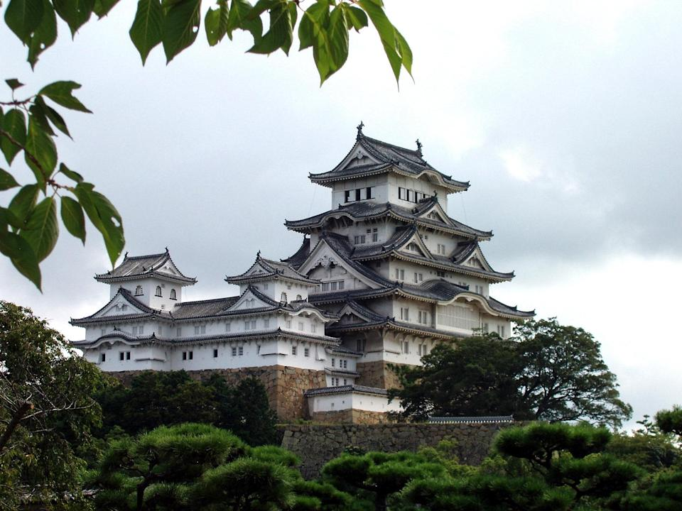 "Himeji Castle dates to 1333 and is regarded as one of the greatest remaining examples of <a href=""https://www.cntraveler.com/gallery/most-beautiful-places-in-japan?mbid=synd_yahoo_rss"" rel=""nofollow noopener"" target=""_blank"" data-ylk=""slk:Japanese castle"" class=""link rapid-noclick-resp"">Japanese castle</a> architecture. It also has some rather eerie folklore associated with it. The most popular tale tells the story of Okiku, a mythical character from ancient legends who was falsely accused of losing valuable dishes. She was killed and thrown into the well in the castle. Her ghost now haunts the castle at night, counting dishes in a mournful tone; she reaches nine before shrieking and returning to the well."