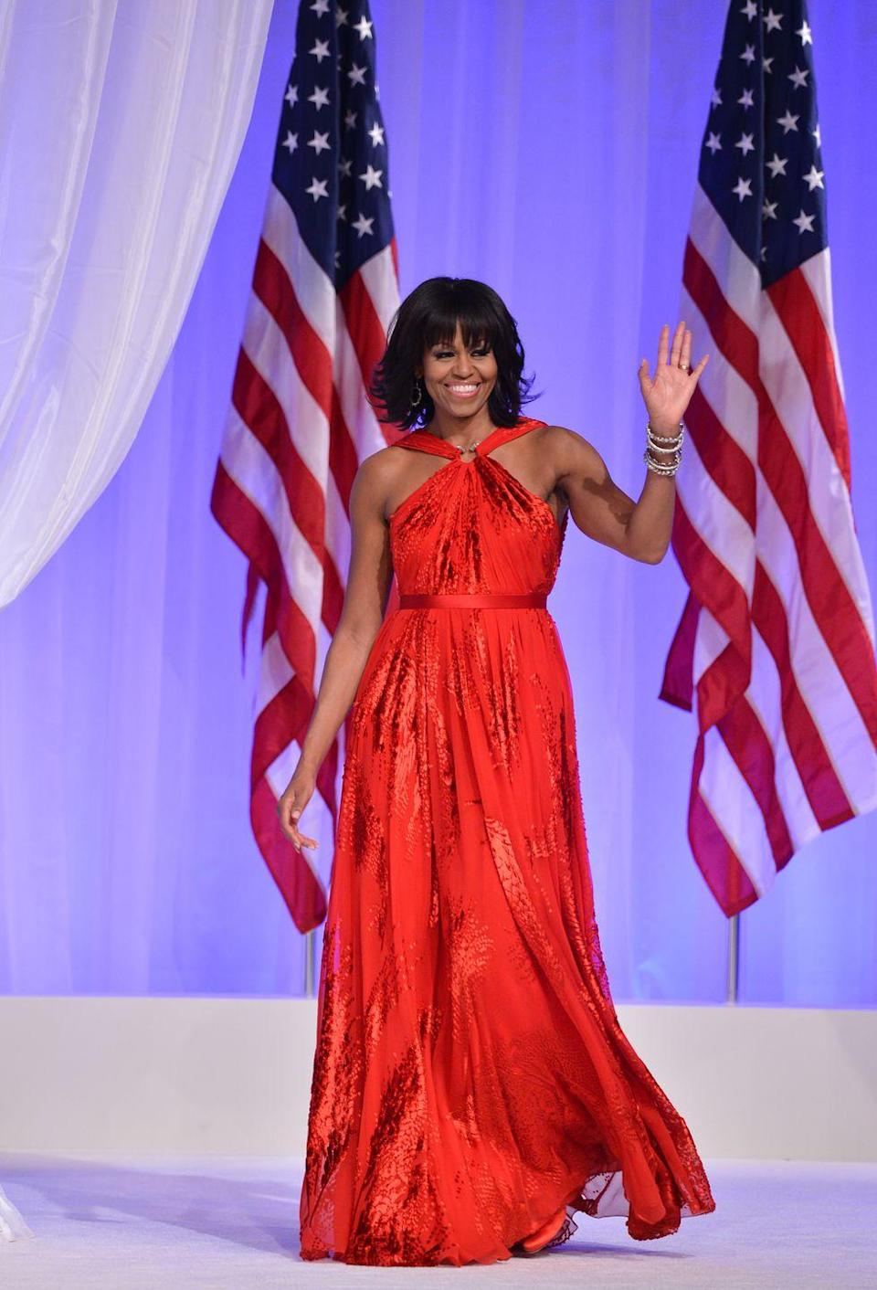 <p>Most first ladies before Michelle Obama would never have dared to wear a halter dress, which is why this ruby-red chiffon and velvet halter-neck gown by Jason Wu that she wore to Barack Obama's second inaugural ball is next-level iconic.</p>