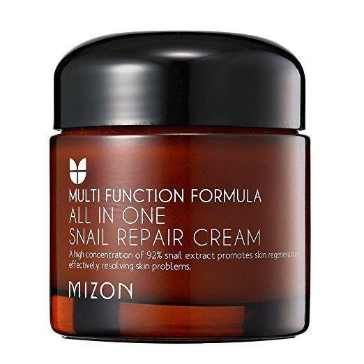 """We're back with the snail extract and that's because it provides so many benefits. This cream packs a punch, providing solutions for anti-aging, acne scars, blemished skin, and more. Get it <a href=""""https://www.amazon.com/MIZON-Snail-Repair-Cream-Grams/dp/B00AF63QQE/ref=lp_7761243011_1_1_a_it?srs=7761243011&ie=UTF8&qid=1505924726&sr=8-1&th=1"""" target=""""_blank"""">here</a>."""
