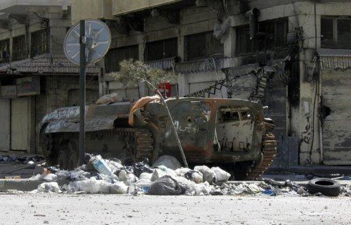Picture released by the Syrian opposition's Shaam News Network shows the wreckage of a tank on a street in Homs, April 28. AFP is using pictures from alternative sources as it was not authorised to cover this event and is not responsible for any alteration shwihc cannot be independently verified
