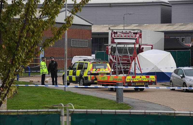 Police gather at the site where 39 bodies were found inside a truck container at Waterglade Industrial Park in Grays, United Kingdom, on Oct. 23, 2019.