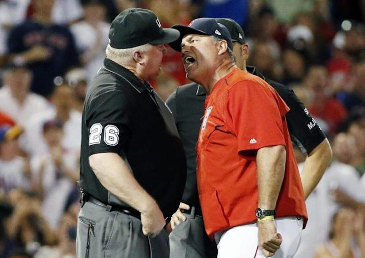 Boston Red Sox manager John Farrell (right) goes nose-to-nose with umpire Bill Miller after a called balk during Saturday's game. (AP)