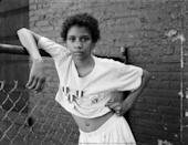 """<p>Another standout from the Sean Kelly booth was this 1988 portrait by American photographer Dawoud Bey. Though Bey's most recent work has drifted into more conceptual territory, his early street photography captured everyday life in Black communities. <em>A Girl with School Medals</em> depicts a young teenager, but her jaunty posture and direct gaze suggest wisdom beyond her years. Missed this photo at Frieze? Check out Bey's <a href=""""https://whitney.org/exhibitions/dawoud-bey"""" rel=""""nofollow noopener"""" target=""""_blank"""" data-ylk=""""slk:show"""" class=""""link rapid-noclick-resp"""">show</a> at the Whitney Museum of American Art, on view through October 3.</p>"""