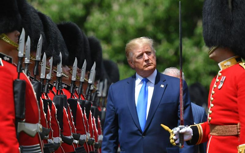 Donald Trump at a Buckingham Palace welcoming ceremony during the state visit - MANDEL NGAN / AFP