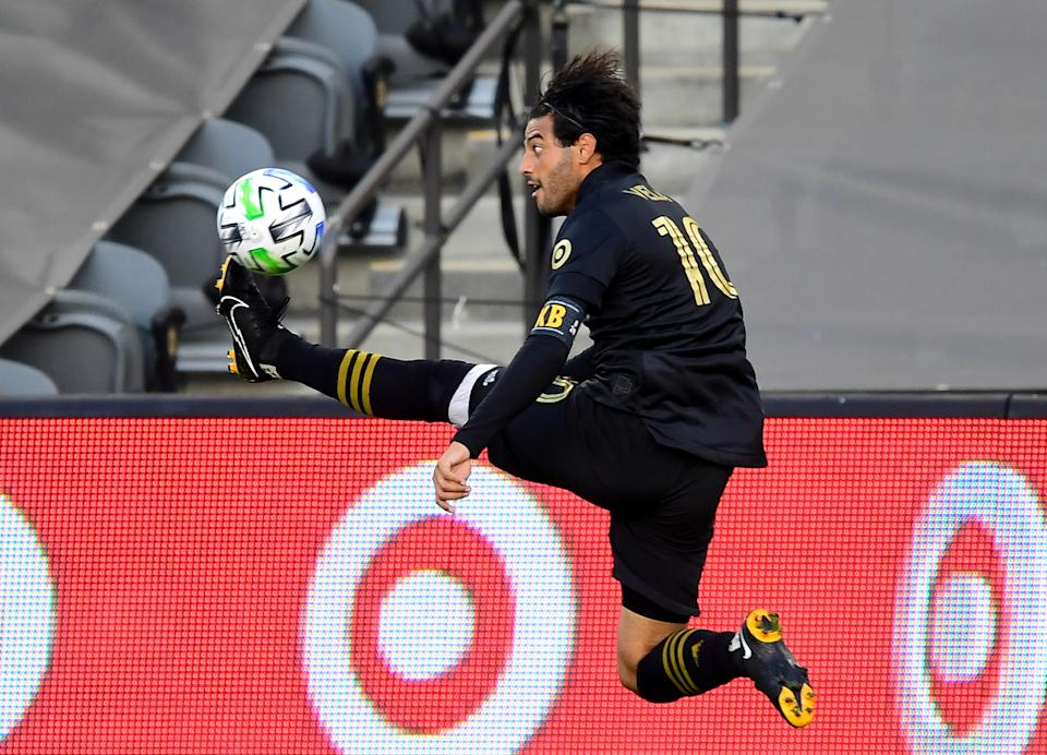 LOS ANGELES, CA - NOVEMBER 08: Carlos Vela #10 of the Los Angeles FC kicks the ball in the game against the the Portland Timbers at Banc of California Stadium on November 8, 2020 in Los Angeles, California. (Photo by Jayne Kamin-Oncea/Getty Images)