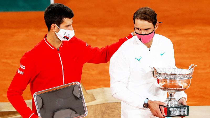 Novak Djokovic (pictured left) puts his arm on Rafa Nadal (Pictured right) after losing the French Open final.