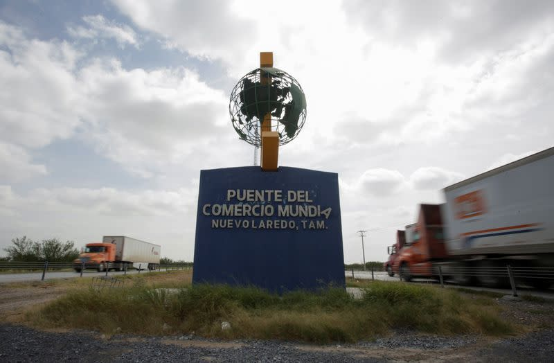 Trucks are seen near the border customs control before crossing into the U.S., at the World Trade Bridge in Nuevo Laredo