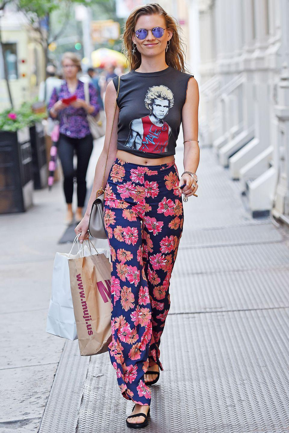 <p>Printed trousers can really pack a punch, as shown by Behati Prinsloo – and they are great for that in-between weather. Pair them with a simple T-shirt and sandals when it's warm, then slip on Converse trainers and a denim jacket when the evening breeze hits.</p>