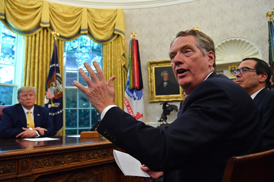 US Trade Representative Robert Lighthizer (C) speaks to the press alongside US Treasury Secretary Steven Mnuchin (R) and US President Donald Trump after announcing an initial deal with China. (Photo: NICHOLAS KAMM/AFP via Getty Images)