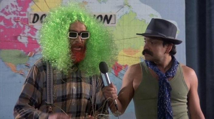 Cheech and Chong standing in front of a map