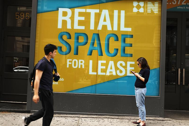 NEW YORK, NY - APRIL 17: People walk by empty retail space in lower Manhattan on April 17, 2017 in New York City. As American's shopping habits continue to migrate online, brick-and-mortar stores across the country are closing at an increased rate. For the first time in nearly two years, retail sales declined two months in a row according to recently released figures from the Commerce Department. Millennials, who often prefer Amazon and other online businesses, are also putting more of their money into vacations and restaurants instead of merchandise. (Photo by Spencer Platt/Getty Images)