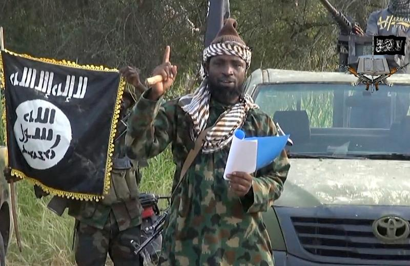 A screengrab taken on October 2, 2014 from a video released by the Nigerian Islamist group Boko Haram shows the group's leader, Abubakar Shekau, gesturing as he delivers a speech (AFP Photo/)
