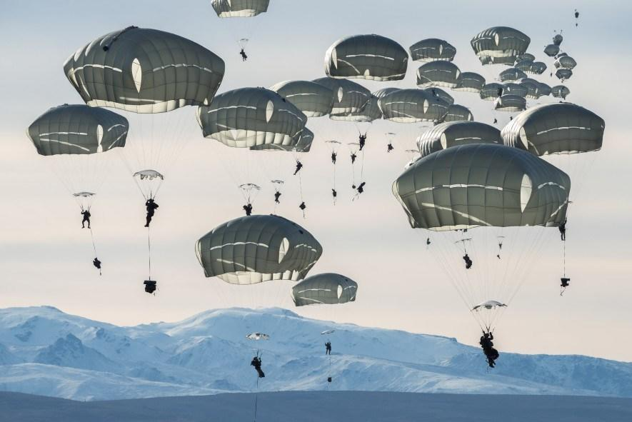 Some 400 US soldiers practice parachute jumps near Alaska's Fort Greely. The multinational exercise, which includes Canadian forces, prepares troops for the rigours of large, coordinated operations in extreme cold conditions. (National Geographic/Pascal Maitre)