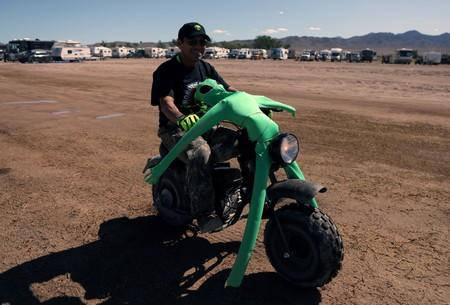 A man rides a motorcycle with an alien doll strapped to it as an influx of tourists responding to a call to 'storm' Area 51, in Rachel, Nevada