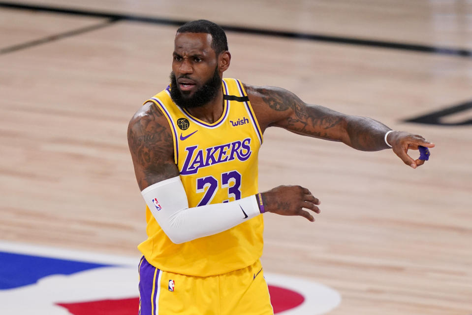 Los Angeles Lakers forward LeBron James reacts during the first half in Game 4 of basketball's NBA Finals against the Miami Heat Tuesday, Oct. 6, 2020, in Lake Buena Vista, Fla. (AP Photo/Mark J. Terrill)