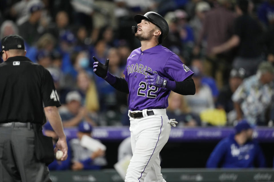 Colorado Rockies' Sam Hilliard gestures as he crosses home plate after hitting a two-run home run off Los Angeles Dodgers relief pitcher Alex Vesia in the seventh inning of a baseball game Wednesday, Sept. 22, 2021, in Denver. (AP Photo/David Zalubowski)