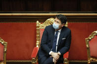 Italian Prime Minister Giuseppe Conte attends the debate at the Senate prior to a confidence vote, in Rome, Tuesday, Jan. 19, 2021. Italian Premier Giuseppe Conte fights for his political life with an address aimed at shoring up support for his government, which has come under fire from former Premier Matteo Renzi's tiny but key Italia Viva (Italy Alive) party over plans to relaunch the pandemic-ravaged economy. (Yara Nardi/pool photo via AP)