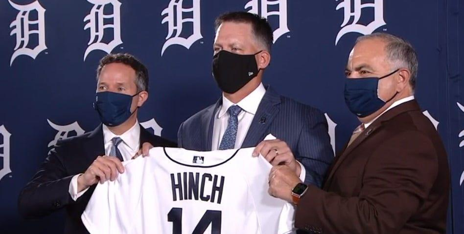 Detroit Tigers CEO and chairman Christopher Ilitch, left, and general manager Al Avila, right, introduce A.J. Hinch as manager on Oct. 30, 2020.