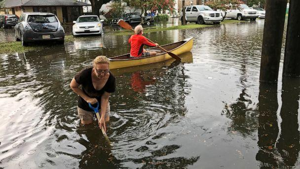 PHOTO: People cope with the aftermath of severe weather in the Broadmoor neighborhood in New Orleans, Wednesday, July 10, 2019. (Nick Reimann/The Advocate via AP)