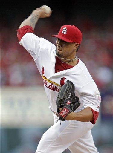 St. Louis Cardinals starting pitcher Kyle Lohse throws during the second inning of a baseball game against the Kansas City Royals, Friday, June 15, 2012, in St. Louis.(AP Photo/Tom Gannam)