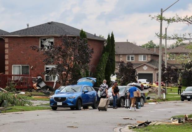 Residents, city crews, and emergency personnel have been cleaning the tornado-affected neighbourhood in Barrie all weekend. (Martin Trainor/CBC - image credit)