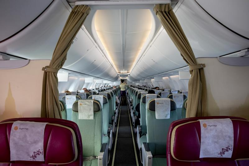 Image: A near-empty Myanmar National airlines flight from Yangon on March 4, 2020. (Paula Bronstein / Getty Images)
